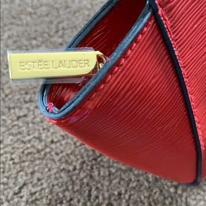 Estée Lauder red makeup bag